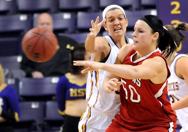 Minnesota State-Moorhead's Megan Strese passes the ball away from Minnesota State's Jamie Bresnahan during the first half of their NSIC tournament quarterfinal game Saturday at Bresnan Arena.