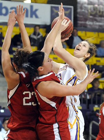 Minnesota State's Ali Wilkinson collides with Minnesota State-Moorhead's Kaycee Charette (23) and Megan Strese during the first half of their NSIC tournament quarterfinal game Saturday at Bresnan Arena.