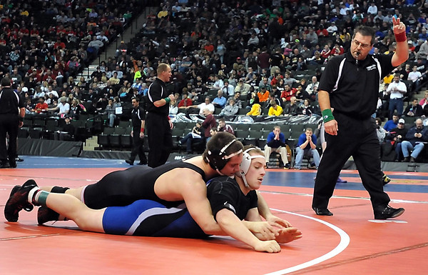 The referee gives Mankato West's Tyler Jakes two points for a takedown of Fairmont/Martin County West's Kory Brown during their Stat Class AA 195 pound quarterfinal match Friday at the Xcel Energy Center in St. Paul.