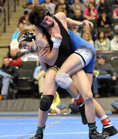 Lake Crystal Wellcome Memorial's Taner Trembley takes down Sibley East's Hunter Retzlaff during their State Class A 138 pound championship match Saturday at the Xcel Energy Center in St. Paul.