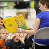 John Cross<br /> Katie Grubisch, a junior in Minnesota State University's College of Education has the undivided attention of kindergarteners attention as she reads them a Dr. Suess book at MSU's Myers Field House. Some 400 kindergarteners were expected to attend a celebration of the children's author as part of the National Education Association's Read Across America Day.