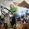 John Cross<br /> Phyclo-Maniacs team members cool off 82-year-old Roy Ganske as he completes his stint during the Pedal Past Poverty event at the YMCA on Saturday.
