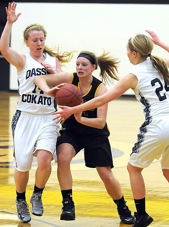 Pat Christman<br /> Mankato East's Claire Ziegler passes out of a Dassel-Cokato double team during the second half Tuesday at the East gym.