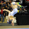 John Cross <br /> Le Sueur Henderson's Austin Anderly does a back flip after winning the Class A championship match in the 106-pound class on Saturday.