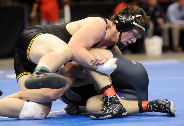 Nathan Rose of Sibley East wrestles Vince Johnson of Windom/Mountain Lake during the 195-pound Class A championship match on Saturday. Rose won 11-3.