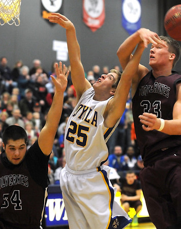 Pat Christman<br /> Mankato Loyola's Taylor Barnes has the ball knocked out of his hands by Mountain Lake Area's Carter Kirk during the first half Friday in Lake Crystal.