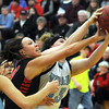 Pat Christman<br /> New Richland-Hartland-Ellendale-Geneva's Paige Overgaard, left, and Tri-City United's Alyshia Angileno reach for a rebound during the first half of their Section 2AA tournament game Thursday at the East gym.