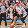 St. Clair's Megan Devens breaks out of a trap by Nicollet/Mankato Loyola's Hayley Selby (left) and Megan Frutiger in the first half of Tuesday's game played at Gustavus. The Cyclones won to advance in the Section 2A tournament. Photo by Jackson Forderer