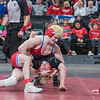 Charlie Pickell of Mankato West arches his back in a last ditch effort before being pinned by Simley's Ryan Sokol in the championship match of the Class AA 132-lb. division. Photo by Jackson Forderer