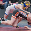 Mason Gehloff of Waseca takes down his opponent Dustin Louwagie from Marshall in the Class AA 106-lb. match. Gehloff won his match for his first state title. Photo by Jackson Forderer