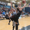 St. Clair's MacKenzie Kruse uses her athleticism to get past Nicollet/Mankato Loyola's Jill Thompson in the first half of Tuesday's Section 2A playoff game. Photo by Jackson Forderer