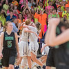 The St. Peter girls basketball team and fans celebrate their sub-section win as dejected Waterville-Elysian-Morristown players walk off the court after having their season ended by the Saints. Photo by Jackson Forderer