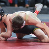 Derek Steele of Sibley East struggles to break free from a hold by Medford's Charley Elwood in the Class A 113-lb. championship match. Steele lost the match to take second place in the division. Photo by Jackson Forderer