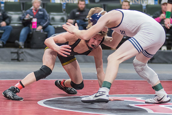 Drayden Morten from Sibley East wrestles his opponent Michael Majerus of Zumbrota-Mazeppa in the Class A 106-lb. match. Morten won the match to win the state title. Photo by Jackson Forderer