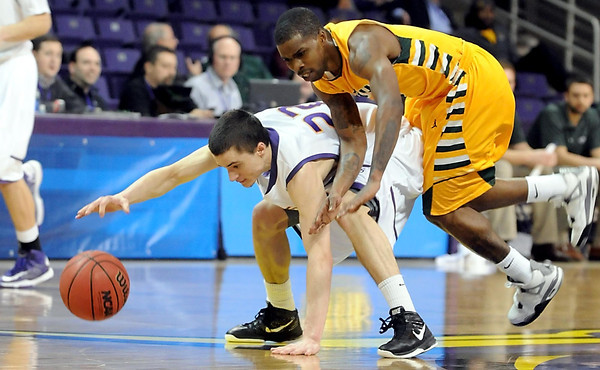 Arkansas Tech's Charles Mells collides with Minnesota State's Zach Monaghan during the second half of their NCAA Division II Central Region quarterfinal game Saturday at Bresnan Arena.