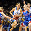 Mankato Loyola's Lindsey Theuninck tries to drive between a pair of Win-E-Mac players during the second half of their State Class A quarterfinal game Thursday at Williams Arena.