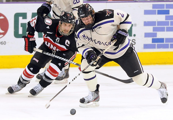 University of Nebraska-Omaha's Brent Gwidt chases Minnesota State University's Josh Nelson during the first period their WCHA playoff game Friday at the Verizon Wireless Center.