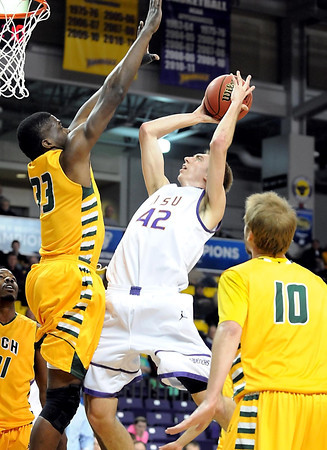 Minnesota State's Connor O'Brien shoots over Arkansas Tech's Charles Mells during the second half of their NCAA Division II Central Region quarterfinal game Saturday at Bresnan Arena.