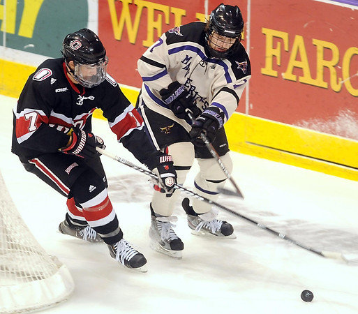 during the second period of their WCHA tournament game Saturday at the Verizon Wireless Center.
