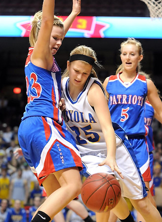 Win-E-Mac's Madison McKeever defends Mankato Loyola's RaeAnn Dose (25) during the second half of their State Class A quarterfinal game Thursday at Williams Arena.