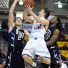 Minnesota State's Zach Monaghan (22) goes up for a layup while defended by Winona State's Caleb Palkert (24) and Xavier Humphrey (5) during their last meeting at Taylor Center Dec. 7.