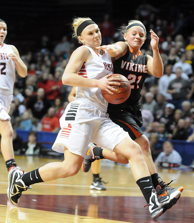 Pelican Rapids' Madison Korf collides with New Richland-Hartland-Ellendale-Geneva's Carlie Wagner during their State Class AA quarterfinal game Wednesday at Williams Arena.