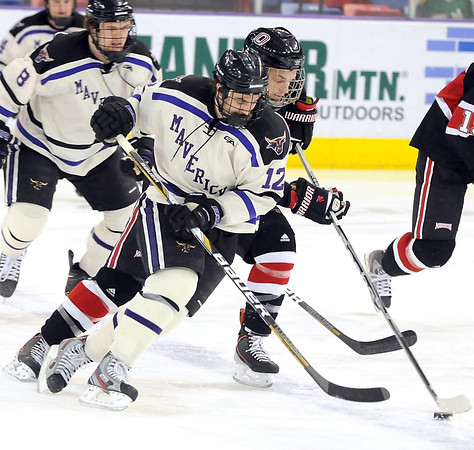 Minnesota State's Jean-Paul Lafontaine and University of Nebraska-Omaha's Andrew Schmit chase the puck during the first period their WCHA playoff game Friday at the Verizon Wireless Center.