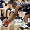 Minnesota State's Zach Monaghan (back) and Winona State's Xavier Humphrey scramble for a loose ball during the overtime period of their NCAA Division II Central Region championship game Tuesday at Bresnan Arena.