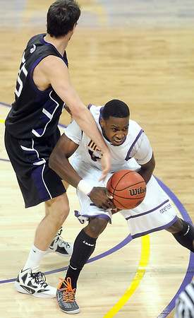 Minnesota State's Jarvis Williams has the ball knocked out of his hands by Winona State's Jordan Fischer during the second half of their NCAA Division II Central Region championship game Tuesday at Bresnan Arena.