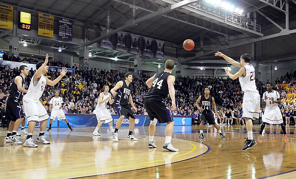 Minnesota State's Zach Monaghan (22) passes the ball during the second half of their NCAA Division II Central Region championship game Tuesday at Bresnan Arena.
