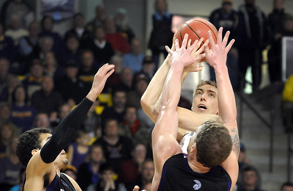 Minnesota State's Connor O'Brien can't get a clear shot around a pair of Winona State defenders during the second half of their NCAA Division II Central Region championship game Tuesday at Bresnan Arena.