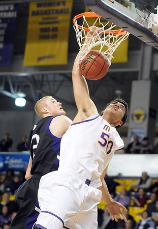 Minnesota State's Assem Marei dunks the ball during the first half of their NCAA Division II Central Region championship game Tuesday at Bresnan Arena.