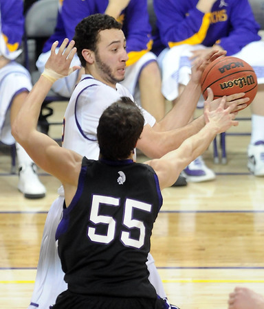 Minnesota State's Gage Wooten passes around the defense of Winona State's Jordan Fiacher during the second half of their NCAA Division II Central Region championship game Tuesday at Bresnan Arena.