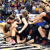 New Richland-Hartland-Ellendale-Geneva players mob teammate Carlie Wagner after defeating Braham 60-59 in the State Class AA girls basketball championship game Saturday at Target Center. Wagner scored 50 points, including two free throws with five seconds left in the game.