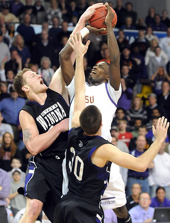 Minnesota State's Jarvis Williams has his shot blocked by Winona State's Clayton Vette near the end of the second half of their NCAA Division II Central Region championship game Tuesday at Bresnan Arena.