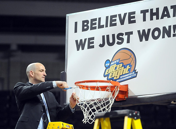 Minnesota State University head coach Matt Margenthaler cuts down the net after his team's 81-63 win over Fort Lewis College to win the NCAA Division II Central Region championship Tuesday at Bresnan Arena.