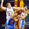 Win-E-Mac's Korbyn Ross collides with Mankato Loyola's Alyssa Mettler (54) and Jordyn Strachan (10) during the first half of their State Class A quarterfinal game Thursday at Williams Arena.