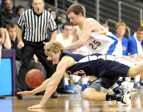 St. Peter's Tommy Steidler and Hayfield's Brady Kramer (25) dive for a loose ball during the second half of their Section 2AA championship game Friday at Bresnan Arena.