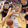 Mankato Loyola's Lindsey Theuninck (3) reaches for a loose ball with Maranatha Christian's Jessie Meyen (23) and Alaina Jarnot (12) during the second half of the Class A quarterfinal game Thursday at Mariucci Arena. Pat Christman