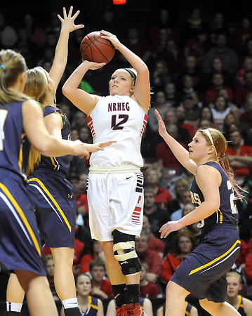NRHEG's Jade Schulz takes a shot during the first half of the Class AA semifinal game Thursday at Williams Arena. Pat Christman