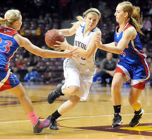 Loyola's RaeAnn Dose drives between a pair of Win-E-Mac defenders during the second half of the Class A semifinal game Thursday at Williams Arena. Pat Christman