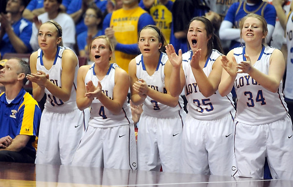 Loyola players cheer during the second half of the Class A semifinal game Thursday at Williams Arena. Pat Christman