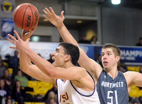 Minnesota State's Assem Marei gets past Northwest Missouri State's Dillon Starzl during the second half of the NCAA Division II Central Region semifinal game Sunday at Bresnan Arena. Pat Christman
