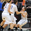 Mankato Loyola's Lindsey Theuninck celebrates with teammates after defeating Maranatha Christian Academy 92-91 in overtime of the Class A quarterfinal game Thursday at Mariucci Arena. Pat Christman