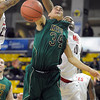 Missouri Southern State's Marquis Addison has the ball knocked out of his hands during the second half of NCAA Division II Central Region semifinal game against Central Missouri Sunday at Bresnan Arena. Pat Christman