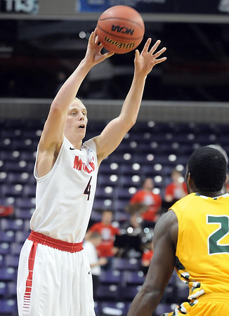 Central Missouri guard and former Mankato West basketball standout Preston Brunz passes the ball during their NCAA Division II Central Region basketball game against Arkansas Tech Saturday at Bresnan Arena. Pat Christman