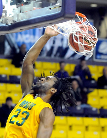 Missouri Southern State's Cameron Cornelius slam dunks the ball during the first half of a NCAA Division II Central Region basketball game Saturday at Bresnan Arena. Pat Christman