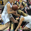 Loyola's Megan Schroeder, left, and Lindsey Theuninck try to get a loose ball away from Maranatha Christian's Alaina Jarnot during the second half of the Class A quarterfinal game Thursday at Mariucci Arena. Pat Christman