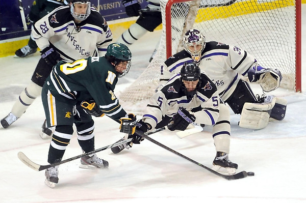 Northern Michigan's Darren Nowick shoots past Minnesota State defender Carter Foguth as goalie Cole Huggins watches during the first period Saturday at the Verizon Wireless Center. Pat Christman