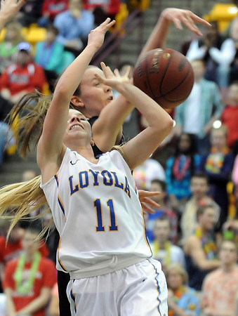 Mankato Loyola's Aunikah Bastian is fouled during the first half of the Class A quarterfinal game against Maranatha Christian Academy Thursday at Mariucci Arena. Pat Christman